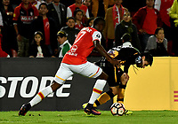 BOGOTA - COLOMBIA – 23 – 05 - 2017: Leyvin Balanta (Izq.) jugador de Independiente Santa Fe, disputa el balon con Diego Wayar (Der.) jugador de The Strongest, durante partido entre Independiente Santa Fe de Colombia y The Strongest de Bolivia, de la fase de grupos, grupo 2, fecha 6 por la Copa Conmebol Libertadores Bridgestone 2017, en el estadio Nemesio Camacho El Campin, de la ciudad de Bogota. / Leyvin Balanta (L) player of Independiente Santa Fe, fights for the ball with Diego Wayar (R) player of The Strongest during a match between Independiente Santa Fe of Colombia and The Strongest of Bolivia, of the group stage, group 2 of the date 6th, for the Conmebol Copa Libertadores Bridgestone 2017 at the Nemesio Camacho El Campin in Bogota city. VizzorImage / Luis Ramirez / Staff.