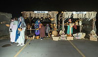 NWA Democrat-Gazette/BEN GOFF @NWABENGOFF<br /> Actors portray a Bethlehem market scene Thursday, Dec. 6, 2018, during a presentation of the 'Bethlehem Revisited' drive-through live nativity scene at Lakeview Baptist Church in Cave Springs. This is the second year the church has done the live nativity scene, with more showings scheduled each night from 6:00 p.m. to 8:00 p.m. though Sunday, weather permitting. A cast of fifty human characters share the spotlight with roughly twenty live animals including horses, goats, chickens and donkeys.