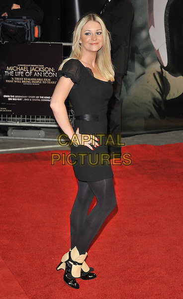 "Nicola Stapleton.The ""Michael Jackson : The Life Of An Icon"" UK premiere, Empire cinema, Leicester Square, London, England..2nd November 2011.full length black top dress leggings side hands on hips beige shoes spats boots.CAP/CAN.©Can Nguyen/Capital Pictures."