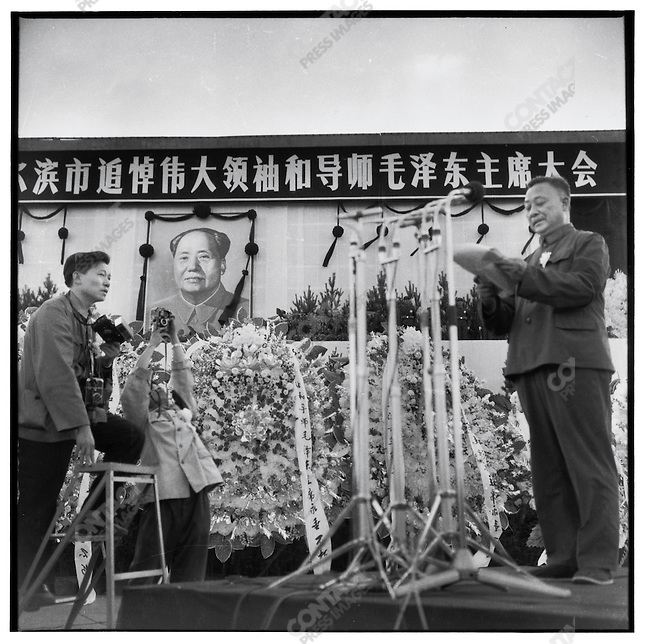 Li Zhensheng during the eulogy by Liu Guangtao the Provincial Communist Party first secretary and director of the Revolutionary Committee, at the memorial service for Mao in Harbin; photograph by Xu Wanyu; Heilongjiang Province, September 18, 1976