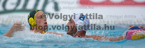 Jamie Beadsworth (L) of Australia fights against Valentino Gallo (R) of Italy for the ball during the Vodafone Waterpolo Cup in Budapest, Hungary on July 15, 2012. ATTILA VOLGYI