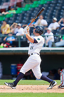 Brent Morel (26) of the Charlotte Knights follows through on his swing against the Gwinnett Braves at Knights Stadium on July 28, 2013 in Fort Mill, South Carolina.  The Knights defeated the Braves 6-1.  (Brian Westerholt/Four Seam Images)