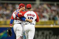 9 March 2009: #16 J.C. Romero of Puerto Rico talks to #4 Yadier Molina during the 2009 World Baseball Classic Pool D game 4 at Hiram Bithorn Stadium in San Juan, Puerto Rico. Puerto Rico wins 3-1 over Netherlands