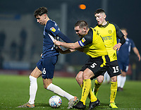 3rd December 2019; Pirelli Stadium, Burton Upon Trent, Staffordshire, England; English League One Football, Burton Albion versus Southend United; Jake Buxton of Burton Albion pulls back Isaac Hutchinson of Southend United  - Strictly Editorial Use Only. No use with unauthorized audio, video, data, fixture lists, club/league logos or 'live' services. Online in-match use limited to 120 images, no video emulation. No use in betting, games or single club/league/player publications