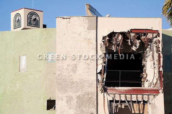 A close up of a torn building at the demolition site of the Bay Meadows Race Track. The demolition of the Bay Meadows Race Track facilities took place from September to October 2008. The horse racing track was demolished to make way for a large mixed use development including office space, residential units, retail space, and public parks. The site is located right next to the Hillsdale Caltrain station making it a perfect location for a transit oriented development (TOD) project. San Mateo, California, USA