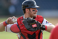 Catcher Kole Cottam (39) of the Greenville Drive warms up before a game against the Hickory Crawdads on Wednesday, May 15, 2019, at Fluor Field at the West End in Greenville, South Carolina. Greenville won, 6-5. (Tom Priddy/Four Seam Images)