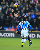 9th February 2019, The John Smith's Stadium, Huddersfield, England; EPL Premier League football, Huddersfield versus Arsenal; Aaron Ramsey of Arsenal wins a header under pressure from Adama Diakhaby of Huddersfield Town