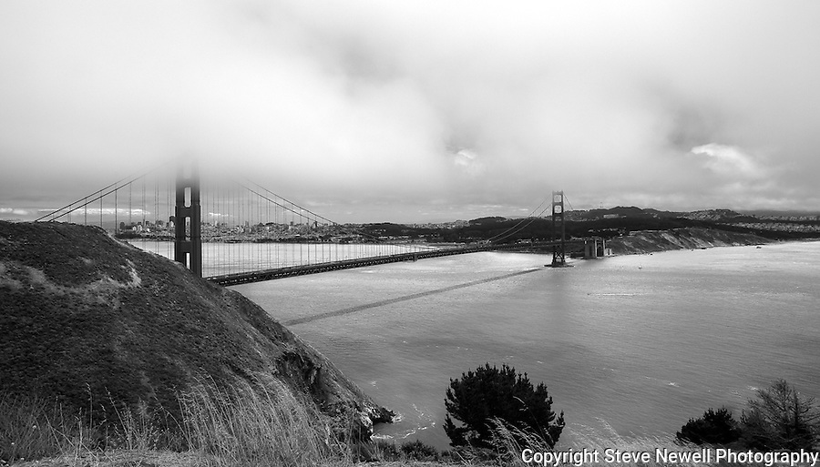 """Chrysopylae"" Black and White Golden Gate Bridge, San Francisco The title is in reference to Captain John C. Freemont's original naming of the Golden Gate strait in 1848.  Chrysopylae is Greek for Golden Gate.  People often ask why the Golden Gate Bridge is named like it is when the bridge's color is actually red and this is why."