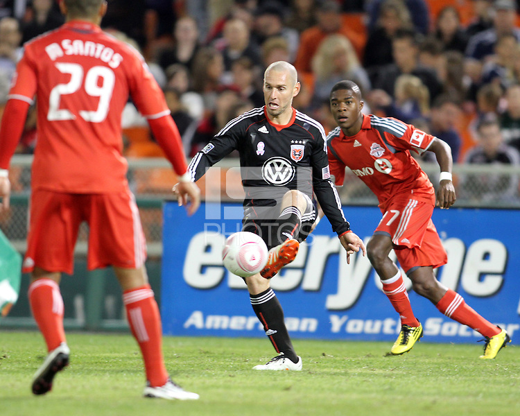 Kurt Morsink #6 of D.C. United slips the ball between Malcon Santos #29 and Nicholas Lindsay #37 of Toronto FC during an MLS match that was the final appearance of D.C. United's Jaime Moreno at RFK Stadium, in Washington D.C. on October 23, 2010. Toronto won 3-2.