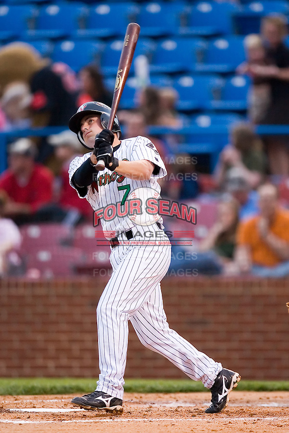 C.J. Lang (7) of the Winston-Salem Warthogs follows through on his swing versus the Salem Avalanche at Ernie Shore Field in Winston-Salem, NC, Friday April 11, 2008.