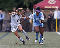 Boston College midfielder Coco Woeltz (2) and University of North Carolina forward Amber Munerlyn (8).  University of North Carolina (blue) defeated Boston College (white), 1-0, at Newton Campus Field, on October 13, 2013.