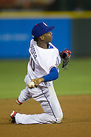 Round Rock Express shortstop Jurickson Profar #10 makes a throw to first base from one knee against the Omaha Storm Chasers in the Pacific Coast League baseball game on April 4, 2013 at the Dell Diamond in Round Rock, Texas. Round Rock defeated Omaha in their season opener 3-1. (Andrew Woolley/Four Seam Images).
