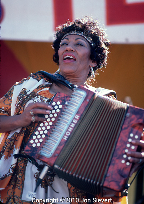 Queen Ida, Sept 1985, San Francisco Blues Festival. American accordionist. She was the first female accordion player to lead a zydeco band. Queen Ida's music is an eclectic mix of R&B, Caribbean, and Cajun, though the presence of her accordion always keeps it traditional.