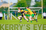 Gneeveguilla's Mike B Murphy tries to hold back Colm Cooper of Dr Crokes in Gneeveguilla last Sunday evening in round 1 of the Garvey's Supervalue County Senior Championship. 5  14  3