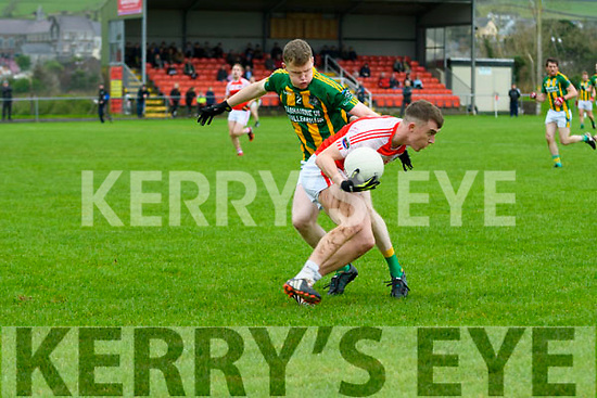 Daingean Uí Chúis Cathal Ó Bambaire in possession of the ball tackled by Lios Póil Ronan Ó Grifín during the West Kerry Championship semi-final match at Pairc an Aghasaigh, Dingle, on Saturday afternoon.