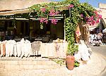 Linen shop and bougainvillea flowers, Rhodes town, Rhodes, Greece