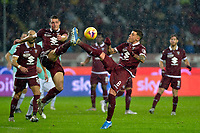 23rd November 2019; Olympic Grande Torino Stadium, Turin, Piedmont, Italy; Serie A Football, Torino versus Inter Milan; Andrea Belotti of Torino FC is injured as he clashes boots with Daniele Baselli of Torino FC as they try to their area - Editorial Use