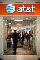 "Grand opening of a new AT&T store in the Queens Center Mall in the New York borough of Queens on Saturday, February 25, 2012.  The new store is bilingual catering to the ethnically diverse population of Queens with signs in Spanish and English and Spanish speaking staff on hand. Former NY Yankee Dwight ""Doc"" Gooden was on hand to sign autographs and greet fans. (© Richard b. Levine)"