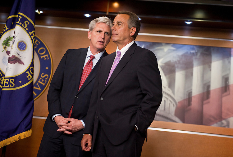 UNITED STATES - JULY 14:  House Majority Whip Kevin McCarthy, R-Calif., left, has a word with Speaker John Boehner, R-Ohio, during a news conference with other House republicans in the Capitol Visitor Center on the topics of a proposed balanced budget amendment and also the ongoing debt ceiling talks.  (Photo By Tom Williams/Roll Call)