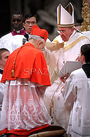 Italian cardinal Lorenzo Baldisseri  receives his beret as he is being appointed cardinal by Pope Francis  at the consistory in the St. Peter's Basilica at the Vatican on February 22, 2014.
