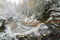 The overview of Laughing Whitefish Falls after a fresh snowfall during the autumn colors. Sundell, MI