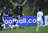 Eric Molloy flies over Freddie Kini's tackle during the 2019 OFC Champions League quarter final football match between Team Wellington and Henderson Eels at David Farrington Park in Wellington on Sunday, 7 April 2019. Photo: Dave Lintott / lintottphoto.co.nz