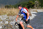 NELSON LAKES, NEW ZEALAND - APRIL 18:  Andy Marr crosses the Travers River during the 2015 Alpine Lodge Loop The Lake trail run at Lake Rotoiti on April 18 16, 2015 in Nelson, New Zealand. (Photo by Marc Palmano/Shuttersport Limited)