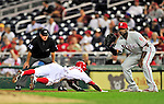 28 September 2010: Philadelphia Phillies' first baseman Ryan Howard stands ready to complete a pick off attempt on a diving Nyjer Morgan during a game against the Washington Nationals at Nationals Park in Washington, DC. The Nationals defeated the Phillies 2-1 on an Adam Dunn walk-off solo homer in the 9th inning to even up their 3-game series one game apiece. Mandatory Credit: Ed Wolfstein Photo