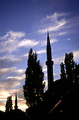 Sarajevo, Bosnia. Minaret of the Muslim cultural centre and mosque in silhouette at sunset.