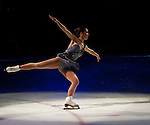 The Skater Extends Her Arms