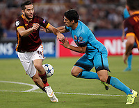 Calcio, Champions League, Gruppo E: Roma vs Barcellona. Roma, stadio Olimpico, 16 settembre 2015.<br /> Roma&rsquo;s Kostas Manolas, left, and FC Barcelona&rsquo;s Luis Suarez fight for the ball during a Champions League, Group E football match between Roma and FC Barcelona, at Rome's Olympic stadium, 16 September 2015.<br /> UPDATE IMAGES PRESS/Isabella Bonotto