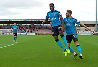 Devante Cole of Fleetwood Town celebrates with Wes Burns of Fleetwood Town (right) after scoring  the opening goal during the Sky Bet League 1 match between Northampton Town and Fleetwood Town at Sixfields Stadium, Northampton, England on 12 August 2017. Photo by Alan  Stanford / PRiME Media Images.