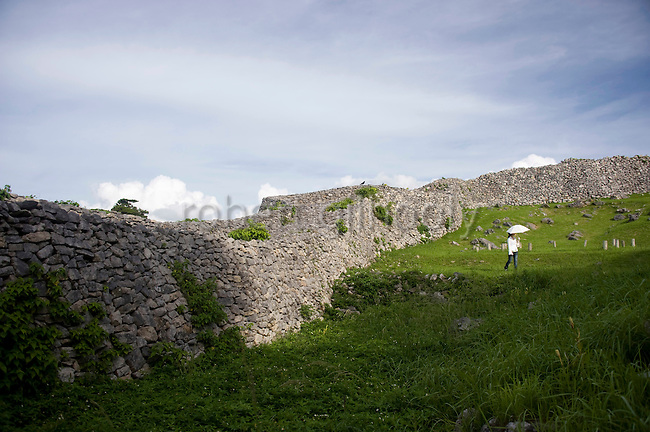 Visitors enjoy  a stroll among what what was formerly the Shijimajokaku Ward, where it is thought the king's most  important subjects resided, at Nakajin Castle ruins in Yomitan VILLAGE, Okinawa Prefecture, Japan, on May 20, 2012. Photographer: Robert Gilhooly