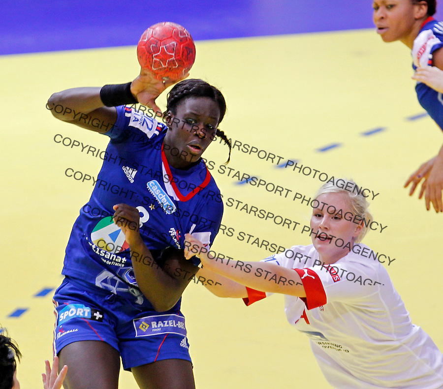 NIS, SERBIA 6/12/2012/ Claudine Mendy (L) of France and Lotte Grigel (R) of Denmark during Women`s European Handball Championship EHF EURO 2012 match between Denmark and France in Cair arena in city of Nis in southern Serbia on  December 6, 2012 Credit: PEDJA MILOSAVLJEVIC/SIPA/