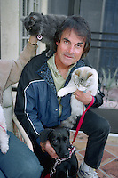 SCOTTSDALE, AZ - Manager Tony La Russa of the Oakland Athletics poses with his dogs and cats for a portrait at his home during spring training in Scottsdale, Arizona in 1994. Photo by Brad Mangin