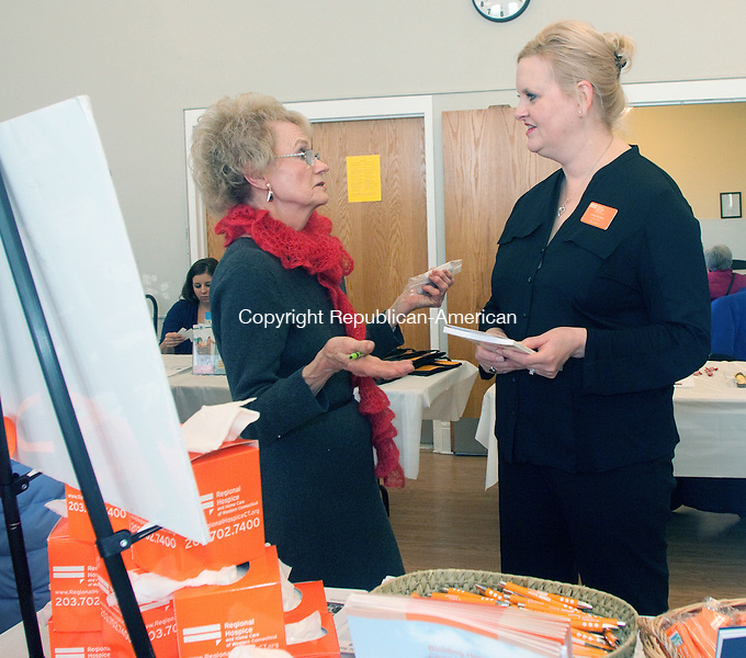 MIDDLEBURY CT- JANUARY 07 2015 010715DA05- Janina B. Nawarskas, left, of Wolcott talks with Linda Pinckney LPN Certified Hospice and Palliatve Care Nurse during a community and health fair with free health screenings, food tasting from chefs and sharing resources were available to senior citizens. The event was hosted by  Shepardson Community Center on Wednesday.<br /> Darlene Douty Republican American