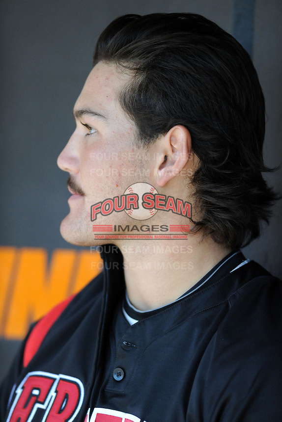 UNLV Runnin' Rebels starting pitcher John Richy #45 in the dugout during a game against the Tennessee Volunteers at Lindsey Nelson Stadium on February 22, 2014 in Knoxville, Tennessee. The Volunteers defeated the Rebels 5-4. (Tony Farlow/Four Seam Images)