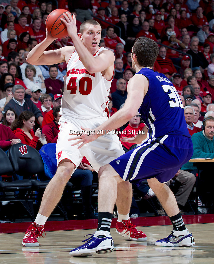 Wisconsin Badgers forward Jared Berggren (40) handles the ball against the Northwestern Wildcats during a Big Ten Conference NCAA college basketball game on January 18, 2012 in Madison, Wisconsin. The Badgers won 77-57. (Photo by David Stluka)