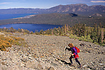 Female hiker on rocky mountain slope, Mount Tallac, near Lake Tahoe, California