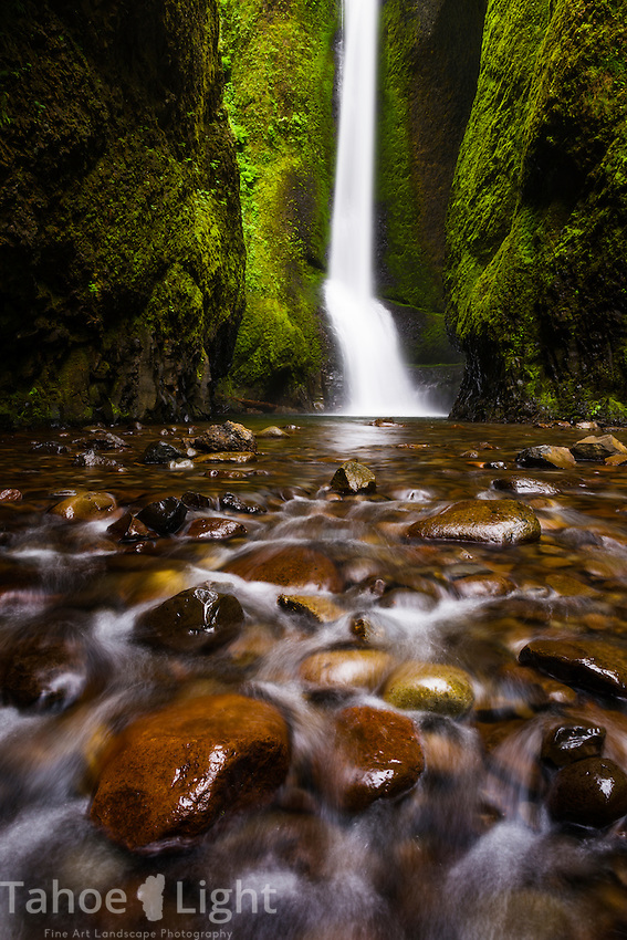Lower Oneonta falls along the Columbia River Gorge just outside of Portland, Oregon is a summer hikers dream. A .5 mile hike in the water along a high walled canyon similar to the Narrows hike in Zion gets you to this low volume waterfall perfect for swimming under. But beware, even at low water there is a big log pile and a chest-deep water crossing to navigate.