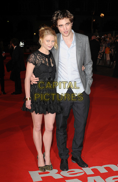 "EMILIE DE RAVIN & ROBERT PATTINSON .UK Premiere of ""Remember Me"" - Arrivals, Odeon Leicester Square, London, England, UK, 17th March 2010..full length black dress lace sheer see thru through bow bare legs shoes gold studded studs bracelet ruffles ruffle tiered arm around grey gray jacket blazer blue shirt hand in pocket trousers .CAP/BEL.©Tom Belcher/Capital Pictures ."
