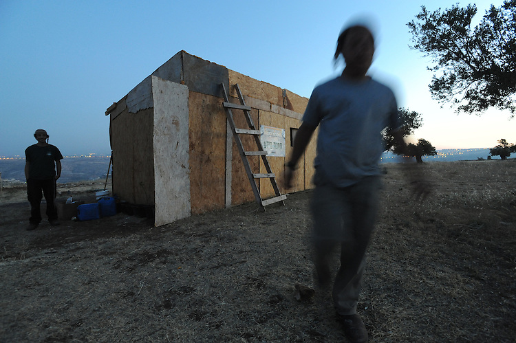 Settler youth near a wooden shack, which they had built in the unauthorized Israeli outpost of Ramat Migron, West Bank.