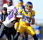 BROOKINGS, SD - OCTOBER 26:  Brandon Hubert #23 from South Dakota State University is brought down by Tate Omli #15 from Northern Iowa in the fourth quarter of their game Saturday afternoon at Coughlin Alumni Stadium in Brookings. (Photo by Dave Eggen/Inertia)