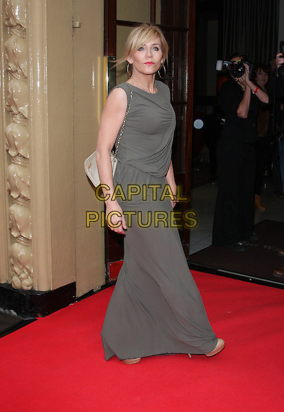 MICHELLE COLLINS.The Tesco Magazine Mum Of The Year 2011 at The Waldorf Hilton Hotel, London, England..February 27th, 2011.full length beige grey gray sleeveless dress side .CAP/JIL.©Jill Mayhew/Capital Pictures