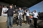 Home supporters watching the second-half action at the Mersey Travel Arena, home to Marine Football Club, as they played host to Ilkeston FC in a Northern Premier League premier division match. The match was won by the home side by 3 goals to 1 and was watched by a crowd of 398. Marine are baed in Crosby, Merseyside and have played at Rossett Park (now the Mersey Travel Arena)  since 1903, the club having been formed in 1894.