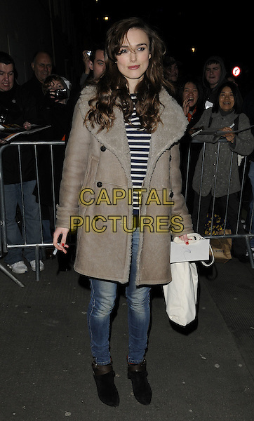 "KEIRA KNIGHTLEY.Leaving after the evening performance of ""The Misanthrope"", Comedy Theatre, London, England, UK, .February 26th 2010..full length grey gray beige sheepskin coat jeans black ankle boots departures top blue and white striped stripes .CAP/CAN.©Can Nguyen/Capital Pictures"