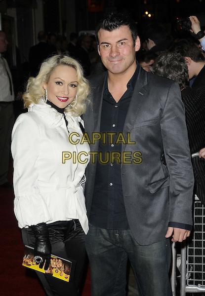 Kristina Rihanoff & Joe Calzaghe .The 'Wild Bill' UK film premiere, Cineworld Cinemas, Haymarket, London, England..March 20th, 2012.half length white jacket black shirt grey gray couple suit gloves .CAP/CAN.©Can Nguyen/Capital Pictures.