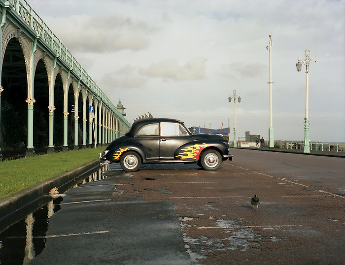 A customised Morris Minor parked on the seafront in Brighton. England 2002.