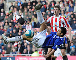 Sunderland's Jonny Evans and Everton's Tim Cahill tries a overhead kick. during the Premier League match at the Stadium of Light, Sunderland. Picture date 9th March 2008. Picture credit should read: Richard Lee/Sportimage