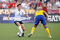 Megan Rapinoe, Sara Larsson #7...USWNT tied Sweden 1-1 at Morrison Stadium, Omaha Nebraska.
